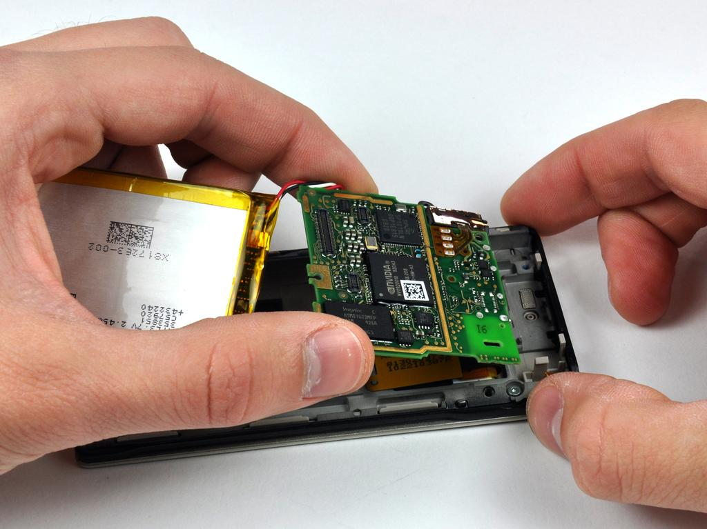 Step 11 For this step, it is recommended to cautiously hold the battery and logic