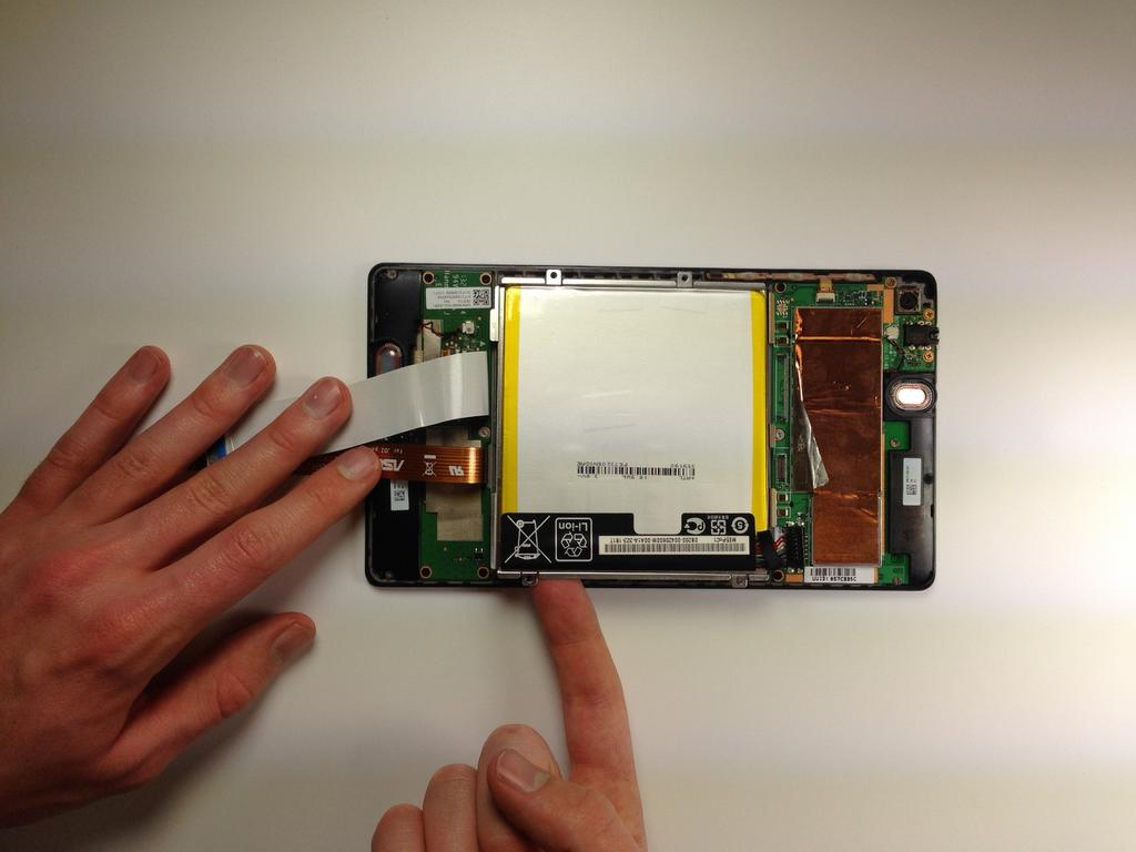 Step 9 Remove the battery from your device by applying pressure at the
