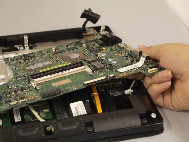 Pull the motherboard out by hand using a counterclockwise motion to remove it.