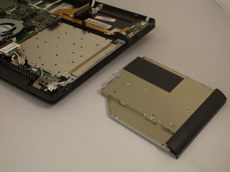 Step 10 Slowly slide out the disc drive,