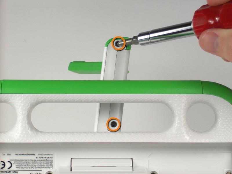 Remove the two 4mm screws with a Phillips #1 screwdriver.