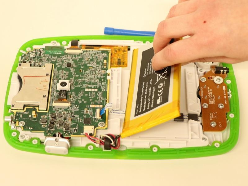 The battery is held in place by an adhesive strip,
