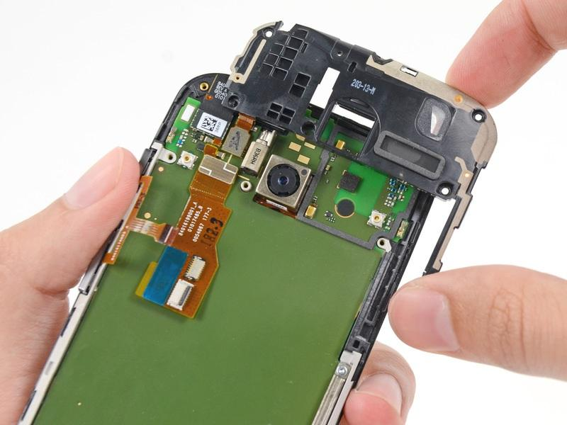 Remove the headphone jack/speaker assembly.