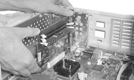 Hardware Installation Power Mac 7200, 7215, WGS 7250 (continued) 13. Align the over the PCI slot (Figure 13).