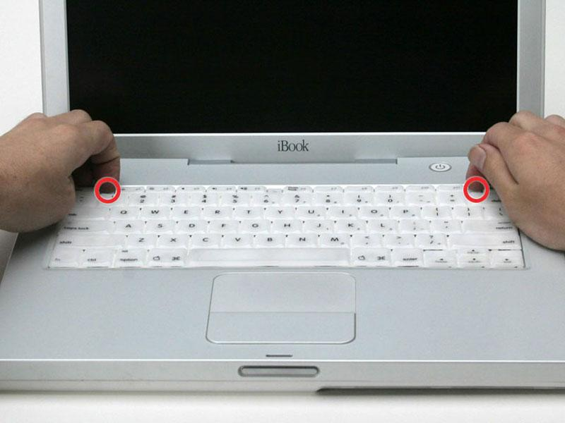 If the keyboard does not come free, use a small flathead screwdriver to turn the keyboard locking screw 180 degrees in either