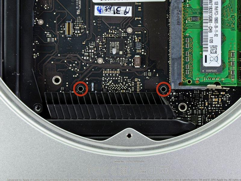 Step 15 To remove the logic board, the two cylindrical rods of the Mac mini Logic Board Removal Tool must be inserted into the holes highlighted in red.