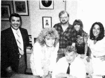 "www.americanradiohistory.com Signing Sylvia. New York Music Co. president Sid Bernstein, seated, signs Sylvia Bennett to the label. Her first release is the 12 -inch single ""You're My Fantasy."